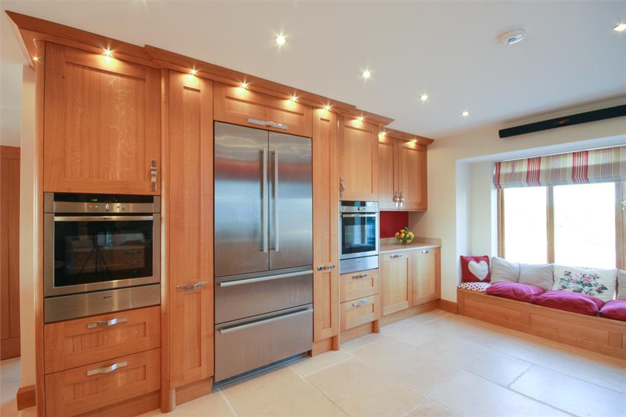 Elegant Oak Shaker Fitted Kitchen With Matching Window Seat. Liebherr Flush Fit Fridge  Freezer And NEFF