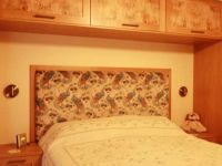 Oak Shaker style bedroom with beautiful character oak panels.