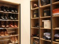 Oak lined walk in wardrobe.