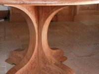 Round pedestal table with burr oak detail and granite top.