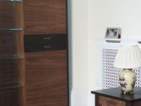 Freestanding bespoke furniture in walnut and Macassar ebony.