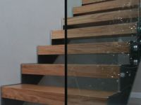 Contemporary staircase, oak, stainless steel and glass.