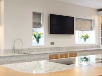 Oak breakfast bar on kitchen island with flush fit hob and downdraft extractor.