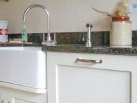 This utility area has a Belfast sink and practical eye to hand storage.