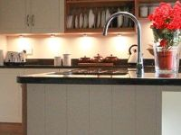 There are two sinks in this kitchen, one on the island opposite the Mercury range cooker.