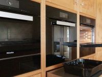 The drawers under the ovens are pull out stainless steel heat proof shelves.