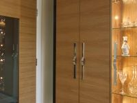 Suspended display cabinet and we also made this large twinning glazed door also soft closing.