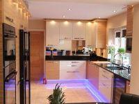 High gloss cream kitchen with Zebrano and Maple furniture. Black granite worktops.