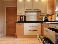 This fitted kitchen has lots of efficient storage, even drawers under the sink.