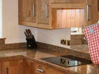 In frame traditional cottage kitchen in pippy oak. Granite worktops, FRANKE sink and tap. Quooker instant boiling water tap.