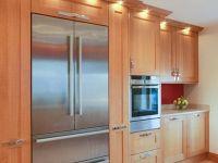 Oak shaker fitted kitchen with matching window seat. Liebherr flush fit fridge freezer and NEFF ovens.