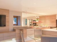 A contemporary fitted kitchen dining room with a large island and breakfast bar.