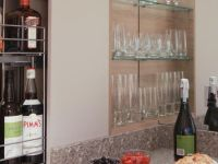 Pull out drinks storage, glasses storage with mirror splashback.