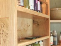 Finial and burr oak detail to pantry storage.